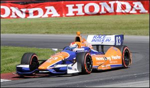 Charlie Kimball takes a corner during his Honda Indy 200 victory at Mid-Ohio Sports Car Course in Lexington, Ohio.