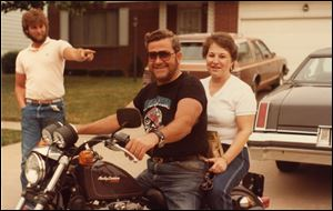 A 1984 photo shows Martin Fewlas on a motorcycle with his wife, Donna Fewlas. Pointing to the couple is Mr. Fewlas' nephew, James McLaughlin.