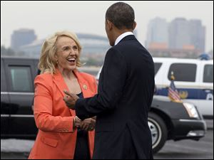 "Arizona Gov. Jan Brewer greets President Barack Obama on his arrival in Phoenix, Tuesday, Aug. 6, 2013. In Arizona the President is expected to tour a construction project and speak about housing, before heading to Los Angeles where he will tape an episode of the ""The Tonight Show with Jay Leno."""