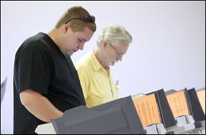 Richard Richie, left, and Michael Richie of Swanton vote during a special election on Tuesday at the American Legion building.