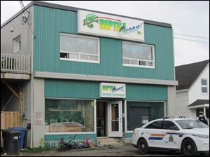 Royal Canadian Mounted Police work at the scene of a fatal python attack at Reptile Ocean exotic pet store in Campbellton, New Brunswick.
