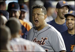 Detroit Tigers' Miguel Cabrera celebrates in the dugout after the Tigers take the lead on a three-run home run by Alex Avila.