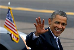 President Barack Obama waves to the crowd as he arrives at Phoenix Sky Harbor International Airport in Phoenix, Tuesday, Aug. 6, 2013, on his way to give a speech on housing and the middle class.