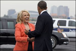 "Arizona Gov. Jan Brewer greets President Barack Obama on his arrival in Phoenix, Tuesday, Aug. 6, 2013. In Arizona the President is expected to tour a construction project and speak about housing, before heading to Los Angeles where he will tape an episode of the ""The Tonight Show with Jay Leno."
