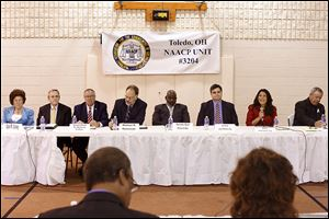 Toledo mayoral candidates Opal Covey, Alan Cox, D. Michael Collins, Michael Konwinski, Mayor Mike Bell, Joe McNamara, Anita Lopez, and Donald Gozdowski come together to meet voters for the first candidates forum, at Indiana Avenue Missionary Baptist Church.