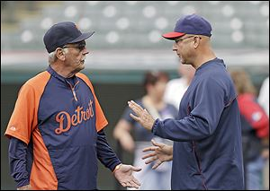 Tigers manager Jim Leyland, left, talks with Indians manager Terry Francona. Detroit leads the AL Central by five games.