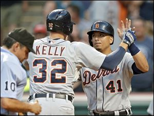 Detroit's Don Kelly is greeted by Victor Martinez after Kelly's three-run home run in the fifth inning Tuesday night against Cleveland.