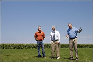 James Zehringer, director of the Ohio Department of Natural Resources, right, speaks with State Rep. Tim Brown, left, and Sen. Randy Gardner about the Ohio Clean Lakes Initiative.