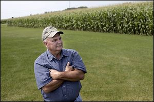 Mike Emch listens to techniques explained by the Ohio Department of Natural Resources in a tour of his family farm in Wood County's Middleton Township .