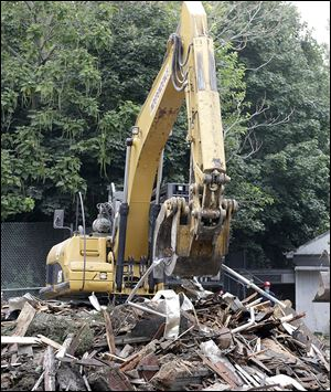 The rubble from Ariel Castro's demolished home is being taken to an undisclosed location, shredded, and burned, so no one could try to take 'souvenirs' and sell pieces of the property online. Castro was forced to turn over the deed to the house.