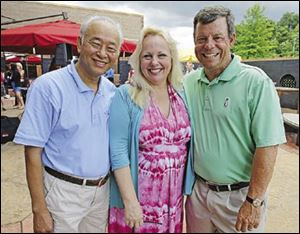 Do Nguyen, Julie Abbey, and Fred Grimm attend the D.O.V.E. event at the Pinnacle in Maumee.