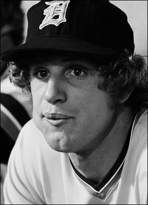 Detroit Tigers pitcher Mark 'The Bird' Fidrych, is shown sitting in the Tigers dugout before a 1976 game in Detroit.