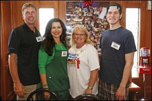 From left, Joe Rombach, Nuestra Gente president linda Parra, vice president Vickie McClellan, and Ramiz Bcharah, at A night with Nuestra Gente fund-raiser  held at La Fiesta Restaurante in Maumee.