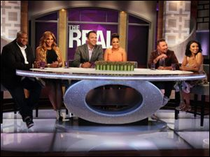Hosts Tamar Braxton, second left, with husband, Vincent Herbert, left, Tamera Mowry-Housley, center, with husband, Adam Housley, and Jeannie Mai with husband Freddy Harteis, on the set of 'The Real.'