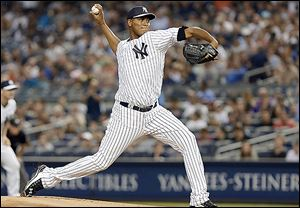Yankees starter Ivan Nova delivers a pitch during the first inning on Friday night. Nova gave up one run in seven innings.