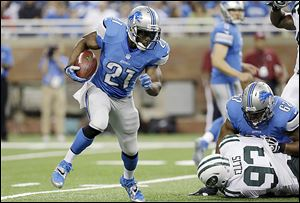 Lions running back Reggie Bush escapes to the outside during the first quarter of a preseason game against the Jets. The game was Bush's debut for Detroit, which signed him in the offseason.