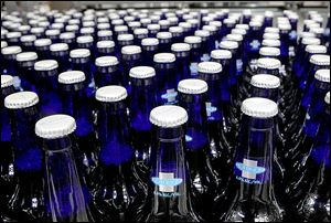 Bottles of Bud Light Platinum move along during the packaging process at an Anheuser-Busch brewery, where the firm has taken risks with new products.