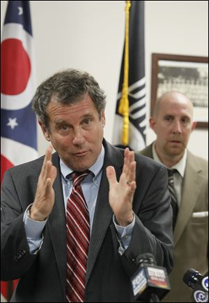U.S. Sen. Sherrod Brown calls the delays at the Department of Veterans Affairs 'inexcusable.' At right is Patrick Grames of Oregon, an Air Force veteran.
