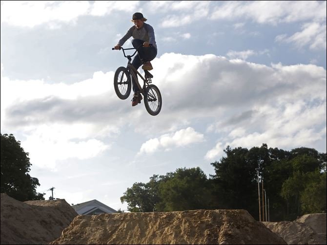 Chris Prebula, 18, of Petersburg, Mich., hits a jump at the Jermain bike park in West Toledo. Prebula has been on a bike since he was three years old, though he just began jumping BMX bikes two years ago.