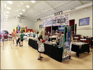 Visitors listen to music, bid on items, and buy products made in Haiti.
