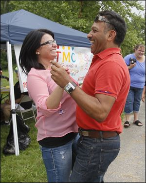 Teachers Malinda Meadows, left, and Euler Hernandez, both of Fremont, dance to the music of Alianza Latina during the farmworker appreciation event.