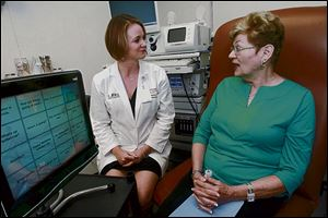 Carole Shearn, right, talks with Jocelyn Odlum, a speech pathologist at the University of Miami Miller School of Medicine.