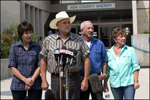 Standing out in front of the Ada County Sheriff's Office in Boise, witnesses, from left to right, Ma