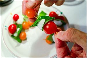 Caprese Skewers in a selection of hors d'oeuvres, perfect for any party, on August 8, 2013.