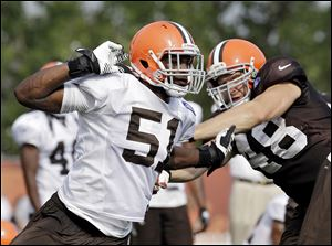 Browns linebacker Barkevious Mingo, left, has impressed his teammates in camp.