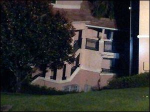 A building  at the Summer Bay Resort in Clermont, Fla, shows damage from collapsing into a sinkhole early Monday Aug. 12, 2013.  No injuries or victims and all emergency responders were safe and uninjured. All guests that were rescued are being moved to a different building on the property.