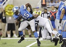 Lions-running-back-Joique-Bell-is-tackle