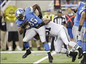 Lions running back Joique Bell is tackled by the Jets' Sheldon Richardson in a preseason game Friday.