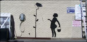 The Banksy graffiti mural entitled,