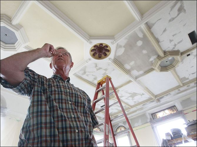 n4ceiling German native Hans Klinck, 65, of Findlay inspects the plaster repairs he made on the original ceiling in Courtroom 1 on the third floor of the Hancock County Courthouse.