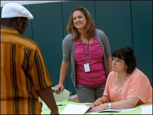 Principal Angela Schaal, center, works with staff members, parents and students during during orientation at Central Trail Elementary School.