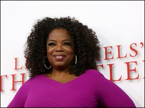 "Oprah Winfrey arrives at the Los Angeles premiere of ""Lee Daniels' The Butler""."