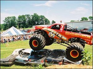 The Raminator monster truck rolls over automobile bodies with no trouble.