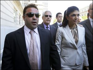 'The Real Housewives of New Jersey' stars Giuseppe 'Joe' Giudice, 43, left, and his wife, Teresa Giudice, 41, of Montville Township, N.J., walk out of Martin Luther King, Jr. Courthouse after an appearance in Newark, N.J. in July.