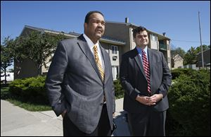 Former Toledo Mayor and Toledo City Council candidate Jack Ford, left, makes 'a public call to action' at the Greenbelt Place Apartments. He is joined by Joe McNamara, Toledo City Council member and Toledo mayoral candidate, right.