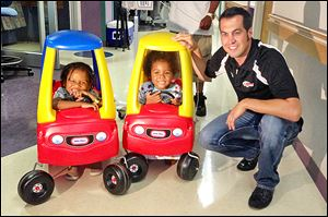 Indy and NASCAR driver Sam Hornish, Jr., visited Mercy Children's Hospital in Defiance. Here he is with Maurice and Mirah Carlton. Mirah visits Mercy occasionally to be treated for Sickle Cell Anemia.