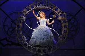 Hayley Podschun, as Glinda the Good Witch, waves to the Munch- kins during 'Wicked.' The production, part of the Theater League's Broadway series, will be at the Stranahan Theater through Sept. 1.