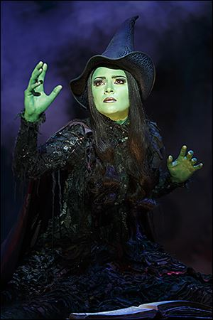 Jennifer DiNoia portrays the green-skinned Wicked Witch of the West in the production at the Stranahan Theater.