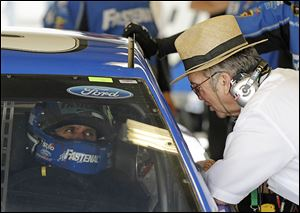 Sprint Cup driver Carl Edwards, left, talks with Jack Roush during a practice for last month's Brickyard 400 in Indianapolis.