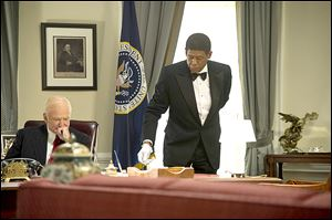 Robin Williams, left, in a scene with Forest Whitaker in Lee Daniels' 'The Butler.'
