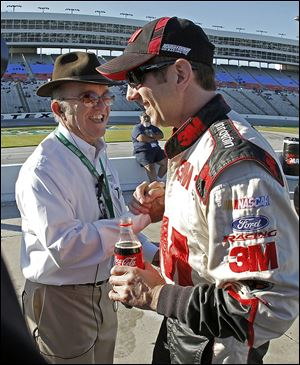 Team owner Jack Roush congratulates Greg Biffle after Biffle won the pole in Texas. Roush's drivers have won two Sprint Cup titles.