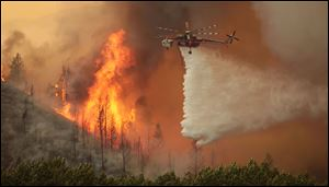 Helicopters battle the 64,000-acre Beaver Creek Fire on Friday north of Hailey, Idaho.