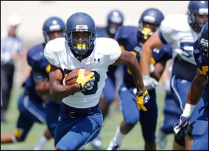 University of Toledo wide receiver Kyle Levere breaks free for a long gain in practice at the Glass Bowl.