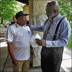 Toledoan Joe Smith, left, talks with Toledo Mayor Mike Bell at a Block Watch event at Ottawa Park.
