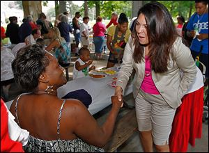 Iris Smith, left, talks with mayoral candidate Anita Lopez during a Block Watch event at Ottawa Park.