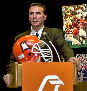 Urban Meyer is introduced as Bowling Green coach Dec. 4, 2000. Meyer left after two seasons to coach at Utah.